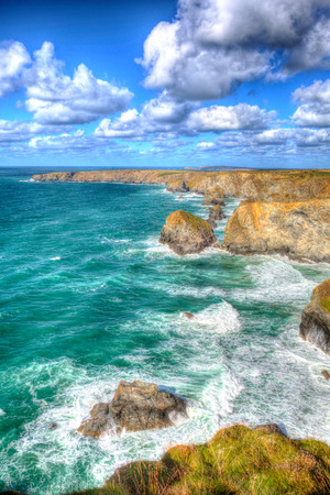 contrasting: Stunning UK coast Bedruthan Steps Cornwall England UK Cornish north near Newquay on a beautiful sunny blue sky day for this tourist attraction Stock Photo