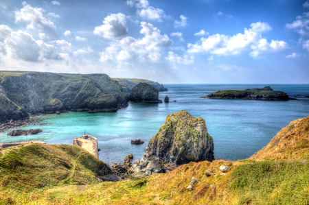 mounts: Mullion Cove harbour Lizard peninsula south Cornwall UK situated on Mounts Bay near Helston within the Cornish Area of Outstanding Natural Beauty