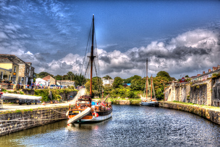 hdri: Tall ship Charlestown harbour near St Austell Cornwall England UK in summer with blue sky and sea with tourists