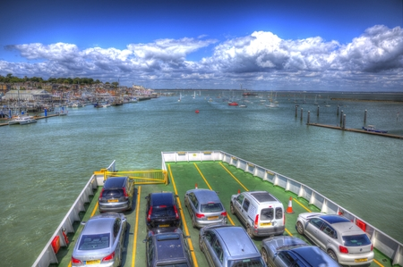 Car ferry leaving port Cowes isle of Wight England UK