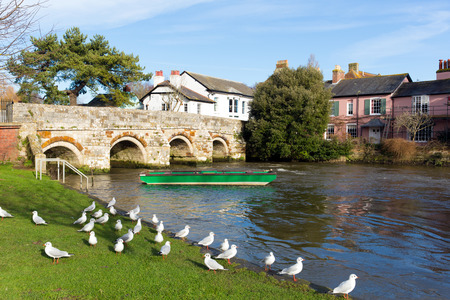 uk: River Avon Christchurch Dorset England UK with bridge and water flowing towards the camera near to Bournemouth and the New Forest Stock Photo