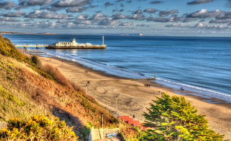 bright colour: Bournemouth beach pier and coast Dorset England UK like a painting in vivid bright colour HDR