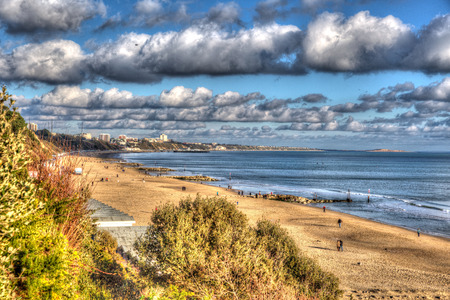 chine: Branksome beach Poole Dorset England UK with cloudscape near to Bournemouth like painting in vivid bright colour HDR