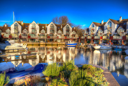 priory: Christchurch Priory Quay Dorset England UK exclusive marina development in vivid bright colour HDR