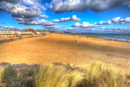 bright colour: Sandbanks beach Poole Dorset England UK with cloudscape like painting in vivid bright colour HDR Stock Photo