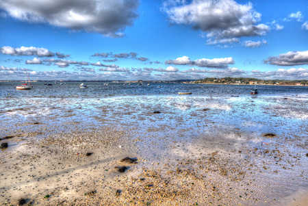 bright colour: View from Sandbanks road Poole Dorset England UK with cloudscape like painting in vivid bright colour HDR