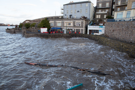 spring tide: Spring high tide brought high waves and even a tree to Madeira Cove Weston-super-Mare on Saturday 21st February 2015