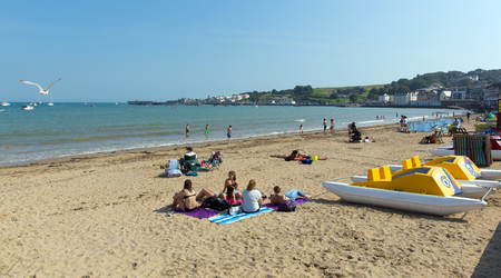 dorset: People enjoying the sandy beach Swanage Dorset England UK and pedalos