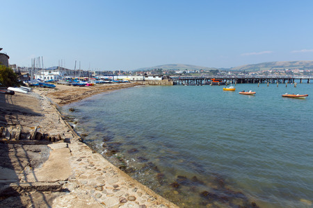 dorset: Swanage harbour and jetty Dorset England UK with sea and coast on a beautiful summer day