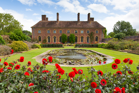 somerset: Barrington Court near Ilminster Somerset England uk Tudor manor house with red dahlias and beautiful gardens in summer Editorial