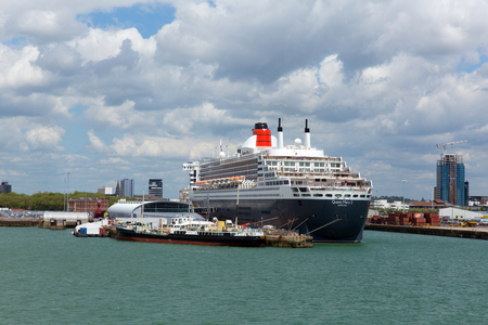 luxery: Luxery cruise ship the Queen Mary 2 ocean going transatlantic liner Southampton Docks England UK in summer on calm day with blue sky