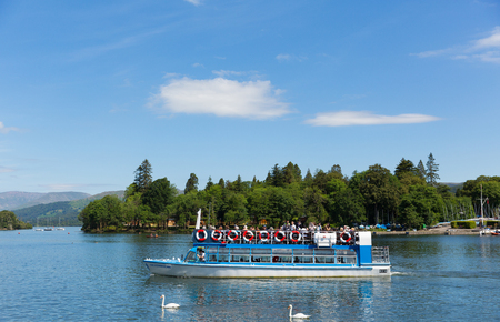 cumbria: Tourists and visitors on pleasure boats Bowness on Windermere South Lakeland Cumbria UK on the banks of Lake Windermere