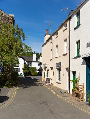 lake district england: Hawkshead village street Lake District England uk on a beautiful sunny summer day popular tourist village