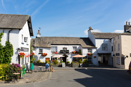 lake district england: Hawkshead village streets with shops in the Lake District England uk on a beautiful sunny summer day popular tourist village Editorial