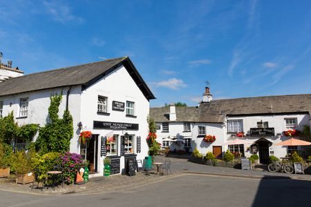 lake district england: Beautiful Hawkshead village Lake District England uk on summer day with pub and shop in this popular tourist destination
