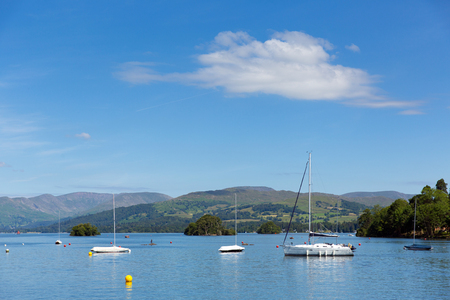 lake district: Engl;ish Lake District Cumbria UK with mountains in summer sun with blue sky Windermere