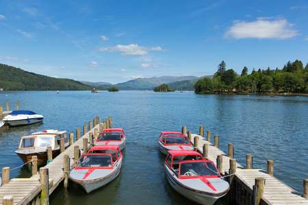 cumbria: Motor boats Bowness on Windermere Lake District Cumbria UK in summer sun with blue sky