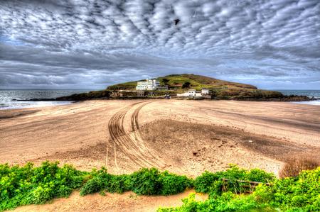 burgh: Burgh Island Devon England uk near Bigbury-on-sea on the south west coast path in bright vivid colourful HDR like painting Stock Photo