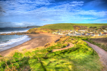 burgh: South west coast path Challaborough South Devon England uk popular surfing beach near Burgh Island and Bigbury-on-sea in bright vivid colourful HDR