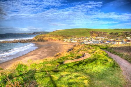 burgh: South west coast path Challaborough South Devon England uk popular surfing beach near Burgh Island and Bigbury-on-sea in bright vivid colourful HDR