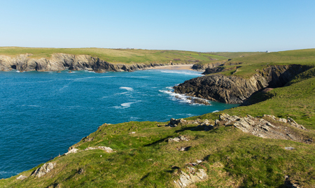 polly: Porth Joke beach by Crantock North Cornwall England UK near Newquay in spring with blue sea and sky