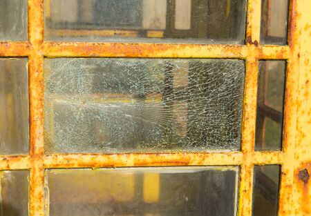 shattered: Old English telephone box shattered glass discoloured texture or background