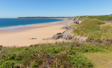 cymru: The Gower Peninsula Pobbles beach Wales uk next to Three Cliffs Bay in summer with blue sky and sea