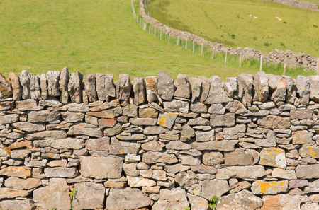 dry stone: Dry stone wall traditional construction The Gower Peninsula South Wales UK with no mortar