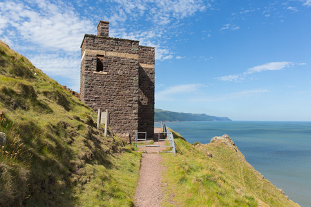 south west england: South west coast path near Porlock Somerset England UK old coastguard lookout tower at Hurlstone Point Stock Photo