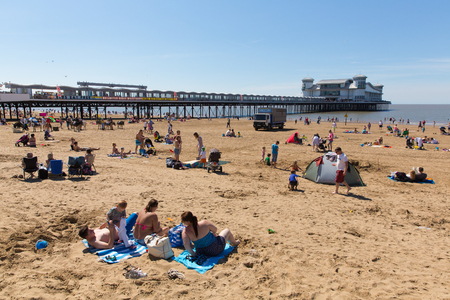 english west country: Weston-super-Mare beach and pier Somerset with tourists and visitors enjoying the summer sun