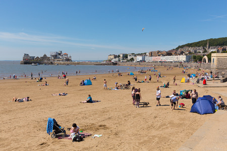 Weston-super-Mare beach and pier Somerset with tourists and visitors enjoying the summer sun