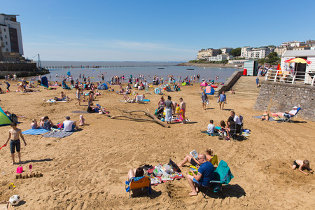 steep holm: Marine lake beach Weston-super-Mare Somerset with tourists and visitors enjoying the August summer sun Editorial