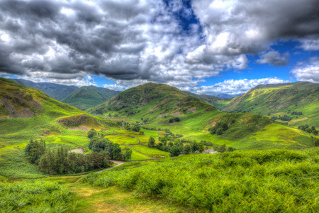 like english: Mountains and valleys in English countryside scene the Lake District Martindale Valley near Ullswater HDR like painting Stock Photo