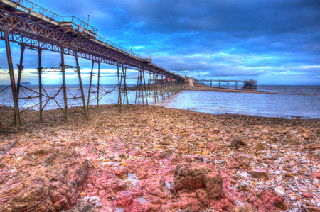birnbeck: English Victorian pier Birnbeck island Weston-super-Mare Somerset England in colourful HDR with rock pools and red rocks in foreground