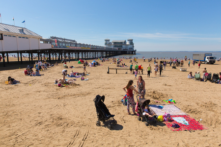 steep holm: English beach scene Weston-super-Mare pier Somerset with tourists and visitors enjoying the summer sun