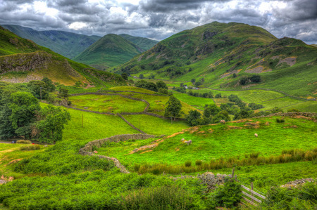 like english: English countryside scene the Lake District Martindale Valley near Ullswater with valley and mountains and green fields in HDR like painting