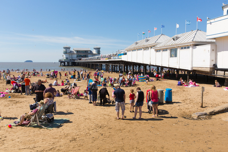 english west country: English summer beach scene Weston-super-Mare beach Somerset with pier tourists and visitors enjoying the summer sun