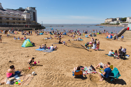 english west country: Marine lake beach Weston-super-Mare Somerset with tourists and visitors enjoying the August summer sun Editorial