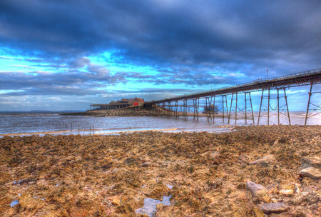 weston super mare: Birnbeck Pier Weston-super-Mare Somerset England in colourful HDR with rock pools and rocks in foreground