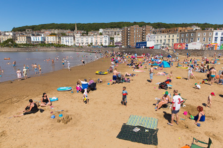 Marine lake beach Weston-super-Mare Somerset with tourists and visitors enjoying the August summer sun Editorial
