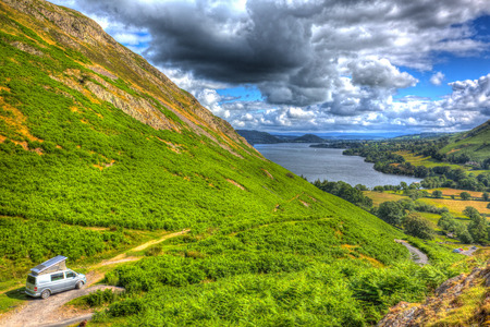 Wildcamping in pop top campervan The Lake District UK with view of Ullswater british countryside in HDR like painting