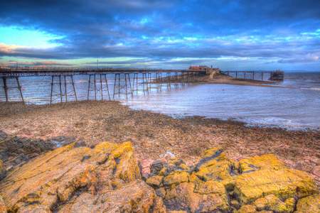 birnbeck: Birnbeck Pier Weston-super-Mare Somerset England in colourful HDR with yellow rocks in foreground