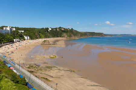 tenby wales: South wales beach Tenby Pembrokeshire uk in summer with tourists and visitors and blue sky