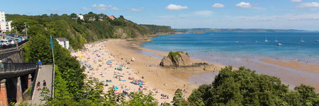 tenby wales: Tenby Pembrokeshire Wales uk north beach in summer with tourists and visitors and blue sky panorama