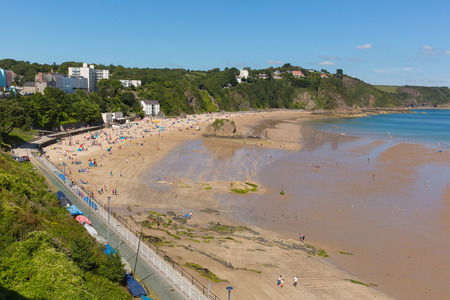 tenby wales: Welsh beach of Tenby Pembrokeshire Wales uk in summer with tourists and visitors and blue sky