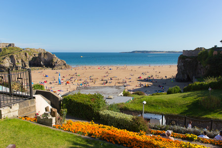 tenby wales: Tenby Pembrokeshire Wales uk castle beach in summer with tourists and visitors and blue sky