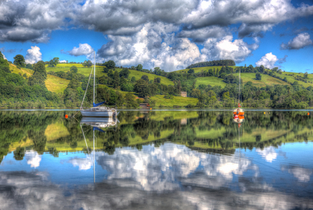 sailing boats: A calm still peaceful lake with sailing boats and hills and clouds
