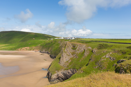 Rhossili coast by the beach and Worms Head The Gower peninsula South Wales UK in the Bristol Channel