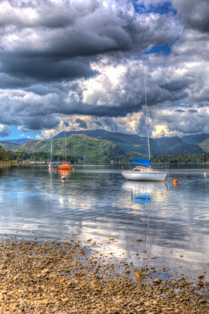 lake district england: British Lake District England UK at Ullswater with sailing boats mountains and clouds on beautiful still summer day with reflections