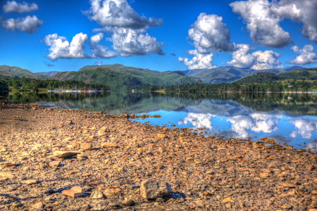 lake district england: English Lake District England UK at Ullswater with mountains and clouds on beautiful still summer day with reflections